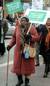 Older woman with a walking stick on the march to the Whittington Hospital London in protest at the threatened closure of its A & E & Maternity Departments through cuts in funding - Stefano Cagnoni - 2010,2010s,activist,activists,against,austerity cuts,BAME,BAMEs,black,BME,bmes,CAMPAIGN,campaigner,campaigners,CAMPAIGNING,CAMPAIGNS,CLOSED,closing,closure,closures,cuts,DEMONSTRATING,Demonstration,DE