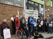 Day of action against welfare cuts protest against benefit cuts at the ATOS Assessment Centre, Jobcentre Plus, Islington. ATOS Healthcare have been awarded the contract to assess claimants for disabil... - Stefano Cagnoni - 17-04-2011
