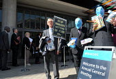 Protestors from the WDM lobby shareholders queueing to attend the 2011 Barclays Bank AGM over the bank's trading in global food prices to increase their overall profit, to the detriment of the poor wh... - Stefano Cagnoni - 27-04-2011