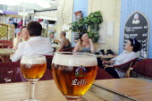 Two glasses of Leffe Beer on a table at a cafe in Arles in southern France. The beer is brewed by InBev Belgium - Stefano Cagnoni - 2010s,2011,alcohol,bar,bars,beer,beers,Belgium,belgium beer,cafe,cafes,catering,customer,customers,drink,drinker,drinkers,drinking,drinks,EBF,Economic,Economy,eu,Europe,european,europeans,French,glass