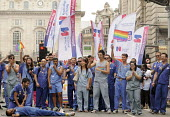 Gay Pride demonstration in London on the 40th anniversary of the first Gay Pride march. RCN members health workers role play life saving resuscitation during the demonstration. - Stefano Cagnoni - 2010s,2011,activist,activists,against,anniversary,CAMPAIGN,campaigner,campaigners,CAMPAIGNING,CAMPAIGNS,CELEBRATE,CELEBRATING,celebration,CELEBRATIONS,College,COLLEGES,DEMONSTRATING,demonstration,demo