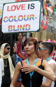 Gay Pride demonstration in London on the 40th anniversary of the first Gay Pride march. Love is Colour Blind reads one placard on the march. - Stefano Cagnoni - 02-07-2011