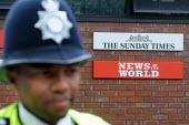 Police presence at a demonstration at the News International Ltd headquarters in Wapping against the dominance of Rupert Murdochs media empire and its alleged immoral and illegal activities in pursuit... - Stefano Cagnoni - 08-07-2011