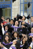 Undergraduates from the London School of Economics, including many higher fee-paying foreign students, celebrate on their graduation day. - Stefano Cagnoni - 15-07-2011