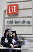 Undergraduates from the London School of Economics, higher fee-paying foreign students, on their graduation day. - Stefano Cagnoni - 2010s,2011,achievement,BAME,BAMEs,BME,bmes,board,bouquet of flowers,bunch of,chinese,cities,city,degree,degrees,diversity,ED Education,edu,educate,educated,educating,education,educational,EMOTION,EMOT