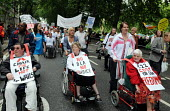 The Hardest Hit - a campaign group of united Disability Rights organisations, protest in London against cuts in disability benefit. It was the biggest ever protest by disabled people in the UK. - Stefano Cagnoni - 2010s,2011,access,activist,activists,against,austerity cuts,benefit cuts,campaign,campaigner,campaigners,campaigning,CAMPAIGNS,carer carers,cut cuts,cuts,DEMONSTRATING,DEMONSTRATION,DEMONSTRATIONS,dis
