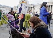 Feed the 5000: people in Trafalgar Square receive a free curry lunch from produce that would otherwise have been thrown away as visually unacceptable by supermarkets. It was prepared by organisations... - Stefano Cagnoni - 2010s,2011,adult,adults,BREAK,CAMPAIGN,campaigning,CAMPAIGNS,child,CHILDHOOD,children,consume,consuming,consumption,DINNER,dinners,DINNERTIME,EARLY YEARS,eat,eating,families,family,feed,feeding,FEMALE