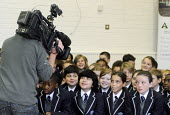 The first ever Year 7 intake at the West London Free School, Hammersmith, London. On the official opening day of their new school being filmed for a news report by a camera operator - Stefano Cagnoni - 09-09-2011