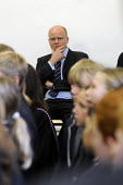 Toby Young, lead proposer for the West London Free School, Hammersmith, looks thoughtfully at the schoolchildren on the offical opening day of the new school. - Stefano Cagnoni - 2010s,2011,assembly,child,CHILDHOOD,children,cities,city,ED Education,edu,educate,educating,education,educational,Free,Free Schools,independent,intelligence,intelligent,juvenile,juveniles,kid,kids,kno