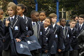 Line up in the playground for the first ever Year 7 intake at the West London Free School, Hammersmith, London. - Stefano Cagnoni - 1st,2010s,2011,adolescence,adolescent,adolescents,BAME,BAMEs,black,BME,bmes,boy,boys,child,CHILDHOOD,children,cities,city,cultural,diversity,ED Education,edu,educate,educating,education,educational,et