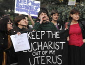 'Keep The Eucharist Out Of My Uterus' reads a banner held by Pro-abortion campaigners in support of a woman's right to choose as they stage a counter demonstration to the '40 Days For Life' anti-abort... - Stefano Cagnoni - 30-03-2012