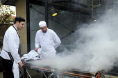 Chefs working at a hotel in York cooking for guests on an outdoor barbecue - Stefano Cagnoni - 16-07-2012