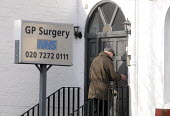 Elderly man entering his GP's Surgery in Archway, north London, for an appointment with his doctor. - Stefano Cagnoni - 24-02-2012