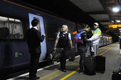 Ashford International Station in Kent: female ticket guard on a late night train into London apologizes to passengers, some with a child, as the train they were travelling on was cancelled, after a re... - Stefano Cagnoni - 09-07-2012