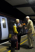 Ashford International Station in Kent: a ticket guard on a late night train into London apologizes to passengers as the train they were travelling on was cancelled, after a relief driver failed to arr... - Stefano Cagnoni - 09-07-2012