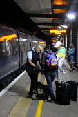 Ashford International Station in Kent: a ticket guard on a late night train into London apologizes to passengers with a child as the train they were travelling on was cancelled, after a relief driver... - Stefano Cagnoni - 09-07-2012