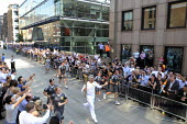 Enthusiastic crowds greet the Olympic Torch Relay as it is carried on to the north side of the Millennium Bridge in central London before being taken by a new torch bearer across the River Thames to s... - Stefano Cagnoni - 26-07-2012
