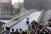 Enthusiastic crowds greet the Olympic Torch Relay as a new torch bearer sets off across the Millennium Bridge across the River Thames to south London. On the other side another huge crowd can be seen... - Stefano Cagnoni - 26-07-2012
