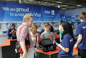 Shoppers paying for goods in the London2012 Megastore inside the Olympic Park in Stratford, on the first competitve day of the London2012 Olympic Games. Visa Cards are the only credit cards accepted f... - Stefano Cagnoni - 26-07-2012