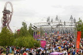 Huge crowds enjoying the atmosphere at the Olympic Park in Stratford on the first competitve day of the London2012 Olympic Games, with The Orbit and the Olympic Stadium visible in the distance - Stefano Cagnoni - 28-07-2012