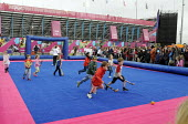 Children play hockey outside the Riverside Arena in the Olympic Park in Stratford at the London 2012 Olympic Games during a break from watching Olympic athletes compete in their own qualifying matches... - Stefano Cagnoni - 31-07-2012