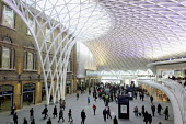 Commuters at the newly opened concourse with a latticework roof, King's Cross Station - Stefano Cagnoni - 2010s,2012,ACE,adult,adults,architecture,ARRIVAL,arrivals,arrive,arrived,arrives,arriving,buildings,busy,cities,city,commute,commuter,commuters,COMMUTING,concourse,customer,customers,developer,develop