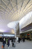 Commuters at the newly opened concourse with a latticework roof, King's Cross Station - Stefano Cagnoni - 2010s,2012,ACE,adult,adults,architecture,ARRIVAL,arrivals,arrive,arrived,arrives,arriving,buildings,busy,cities,city,commute,commuter,commuters,COMMUTING,concourse,customer,customers,departures,develo