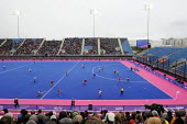 London Prepares test event features a womens hockey game between Argentina and Great Britain in the Riverside Arena at the Olympic Park site in Stratford. - Stefano Cagnoni - 2010s,2012,crowd,event,floodlights,floodlit,game,games,hockey,holiday,holidays,London,Olympic,Olympics,Park,people,PHYSICAL,spectator,spectators,spo,sport,sporting,sports,sticks,team,team gb,teams,tes