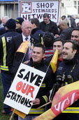 Firefighters rally before lobbying Parliament in protest against proposed cuts to the fire service. - Stefano Cagnoni - 2010s,2012,activist,activists,adult,adults,against,anti,Austerity Cuts,CAMPAIGN,campaigner,campaigners,CAMPAIGNING,CAMPAIGNS,cuts,DEMONSTRATING,demonstration,DEMONSTRATIONS,FBU,fire,fire brigade,firef