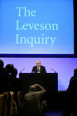 Lord Justice Leveson is photographed by a news photographer as he speaks at his press conference at the QEII Centre to officially launch the results of his Inquiry into media ethics and practise: The... - Stefano Cagnoni - 2010s,2012,conference,conferences,ethics,journalism,journalist,journalists,launch,Leveson,Leveson Inquiry,media,news,photographer,PO Politics,pol,political,POLITICIAN,POLITICIANS,politics,press,reform