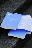 Lying on the steps outside the QEII Centre, not quite in the gutter: official copies of Lord Justice Leveson's Inquiry into media ethics and practise: The Leveson Report. Each costs �250. - Stefano Cagnoni - 2010s,2012,ethics,journalism,journalist,journalists,Leveson,Leveson Inquiry,Lying,media,outside,PO Politics,press,Report,reporter,reporters,reporting