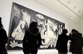 Visitors looking at Picassos Guernica, one of the major artworks of the world, housed at the Reina Sofia Museum in Madrid, Spain. - Stefano Cagnoni - 2010s,2013,ACE,art,arts,attraction,culture,eu,european,europeans,eurozone,exhibition,Fine Art,galleries,gallery,Guernica,holiday,holiday maker,holiday makers,holidaymaker,holidaymakers,holidays,leisur