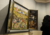 Visitors admire the triptych The Garden of Earthly Delights by Hieronymus Bosch at the Prado Museum of Art in Madrid, Spain. - Stefano Cagnoni - 2010s,2013,ACE,appreciation,art,arts,artwork,artworks,attraction,culture,eu,european,europeans,eurozone,exhibition,fine art,galleries,gallery,Garden,GARDENS,high,holiday,holiday maker,holiday makers,h