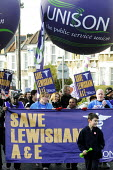 UNISON members on the Save Lewisham Hospital march and rally. Local people protest against the plans to close their local A & E and maternity health facilities. - Stefano Cagnoni - 2010s,2013,activist,activists,against,Austerity Cuts,CAMPAIGN,campaigner,campaigners,CAMPAIGNING,CAMPAIGNS,cuts,demonstrate,DEMONSTRATING,demonstration,DEMONSTRATIONS,FEMALE,health,Hospital,HOSPITALS,