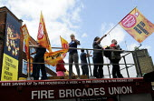 Demonstration by local residents, supporters and trade union members against the planned closure of Clerkenwell Fire Station as part of austerity cuts to public services, passes by the Amnesty Interna... - Stefano Cagnoni - 08-06-2013