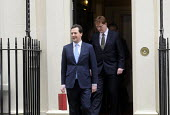 Budget Day 2013. George Osborne MP exits No 11. Downing Street, closely followed by Danny Alexander MP, before presenting the 2013 Budget. - Stefano Cagnoni - 20-03-2013