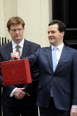 Budget Day 2013. George Osborne MP, exits No 11. Downing Street, closely watched by Danny Alexander MP, before presenting the 2013 Budget. - Stefano Cagnoni - 20-03-2013