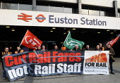 On the fifitieth anniversary of the Beeching Report, members from the RMT, ASLEF & TSSA rail trade unions stage a protest & hand out leaflets to commuters at Euston Station as part of the Action For R... - Stefano Cagnoni - 27-03-2013