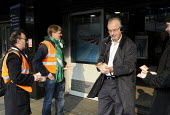 On the fifitieth anniversary of the Beeching Report, members from the RMT, ASLEF & TSSA rail trade unions hand out leaflets to commuters at Euston Station as part of the Action For Rail national campa... - Stefano Cagnoni - 2010s,2013,Action for Rail,activist,activists,against,anniversary,Beeching,campaign,campaigner,campaigners,campaigning,CAMPAIGNS,cuts,DEMONSTRATING,DEMONSTRATION,DEMONSTRATIONS,Euston,fare,fares,journ