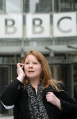 BBC Strike. NUJ & BECTU 12 hour official strike over cuts in staff, compulsory redundancies and management bullying. Michelle Stanistreet, Gen. Sec. of the NUJ talking a mobile telephone outside New B... - Stefano Cagnoni - 2010s,2013,BBC,calls telephone,communicating,communication,conversation,cut cuts,cuts,dialogue,disputes,House,houses,INDUSTRIAL DISPUTE,interview interviewing,interviewee interviewees,job cuts,job los