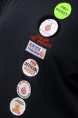 Badges on the jacket of a striking firefighter on the picket line at Euston firestation during the FBU national short four hour strike against plans to change their firefighter members' pension provis... - Stefano Cagnoni - 25-09-2013