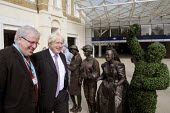 Transport Minister, Patrick McLoughlin & Mayor of London, Boris Johnson are greeted by Victorian themed living statues at the official opening of the newly redeveloped King's Cross Square in front of... - Stefano Cagnoni - 2010s,2013,architecture,ARRIVAL,arrivals,arrive,arrived,arrives,arriving,artwork,artworks,buildings,cities,city,CONSERVATIVE,Conservative Party,conservatives,EBF,Economic,Economy,engineering,facade,in