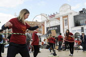 Staff at The Ritzy Cinema in Brixton have fun with hula hoops as they stage a 24 hour strike in support of their claim to be paid the London Living Wage. On zero hour contracts, they are currently pai... - Stefano Cagnoni - 11-04-2014