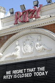 Sign put up by management at the Ritzy Cinema in Brixton as staff there stage a 24 hour strike in support of their claim to be paid the London Living Wage. On zero hour contracts, they are currently p... - Stefano Cagnoni - 2010s,2014,BECTU,cinema,claim,communicating,communication,dispute,DISPUTES,EARNINGS,EQUALITY,female,film,FLAG,flags,Income,INCOMES,INDUSTRIAL DISPUTE,industrial relations,inequality,living wage,London