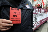 Red Card at the Qatari embassy in London as part of Workers Memorial Day protest against loss of lives in the construction industry building the stadiums for the 2022 Football World Cup to be held in... - Stefano Cagnoni - 28-04-2014