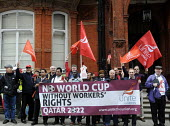 UNITE members hold Red Cards at the Qatari embassy in London as part of Workers Memorial Day protest against loss of lives in the construction industry building the stadiums for the 2022 Football Worl... - Stefano Cagnoni - 28-04-2014