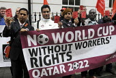 Campaigners hold Red Cards, Qatari embassy in London, Workers Memorial Day protest against loss of lives in the construction industry building the stadiums for the 2022 Football World Cup to be held i... - Stefano Cagnoni - 28-04-2014