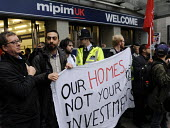 Local community activists protesting at the MIPIM property fair held at Olympia in protest at lack of affordable housing in the UK and especially in London. - Stefano Cagnoni - 2010s,2014,activist,activists,affordable,against,anti,CAMPAIGN,campaigner,campaigners,CAMPAIGNING,CAMPAIGNS,capitalism,capitalist,Commodity Speculation,communities,community,DEMONSTRATING,DEMONSTRATIO
