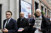 Local community activists protest as attendees queue to get into the MIPIM property fair held at Olympia. The protest was at lack of affordable housing in the UK and especially in London. - Stefano Cagnoni - 15-10-2014