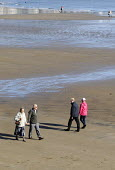 Retired couple taking a walk along the beach, Scarborough, 2014. - Stefano Cagnoni - 2010s,2014,adult,adults,age,ageing population,and,beach,beaches,COAST,coastal,coasts,couple,COUPLES,elderly,exercise,exercises,FEMALE,hand-in-hand,holiday,holiday maker,holiday makers,holidaymaker,hol